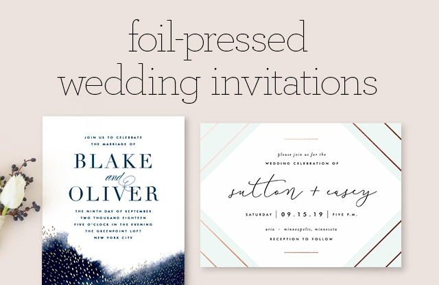 Collection Of Modern Foil Stamped Wedding Invitations Held By Woman In Gold Dress