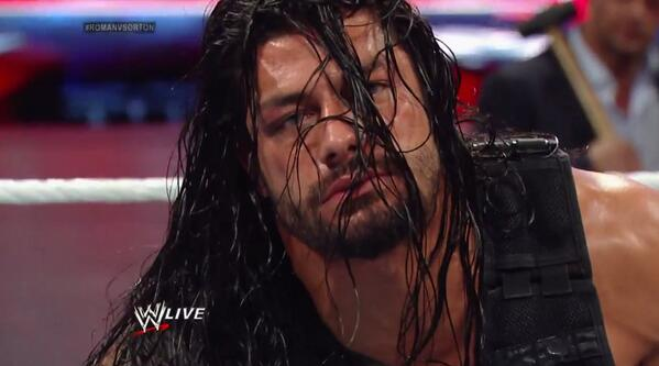 Roman Reigns looking defeated