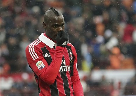 AC Milan forward Mario Balotelli gestures after scoring during the Serie A soccer match between AC Milan and Palermo at the San Siro stadium in Milan, Italy, Sunday, March 17, 2013.