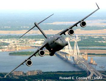 An airplane banks at a steep angle