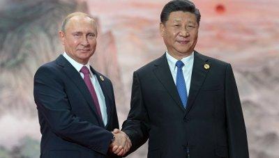 Владимир Путин и председатель КНР Си Цзиньпин перед заседанием Совета ШОС. 10 июня 2018