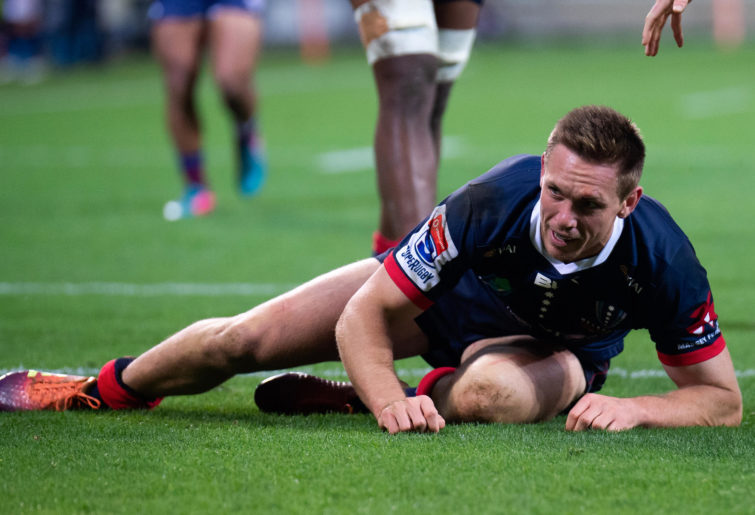 Dane Haylett-Petty of the Rebels looks on as he scores a try