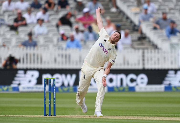 Ollie Robinson of England bowls