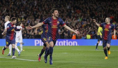 Barcelona's forward David Villa, center, reacts after scoring his side's third goal during the Champions League round of 16 second leg soccer match between FC Barcelona and AC Milan at Camp Nou stadium, in Barcelona, Spain, Tuesday, March 12, 2013.