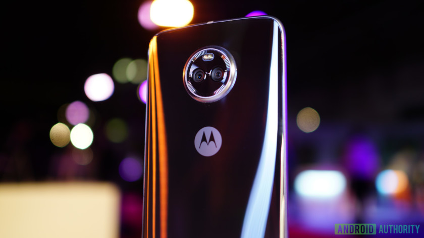 The Moto X4 from behind with out of focus lights in the background.