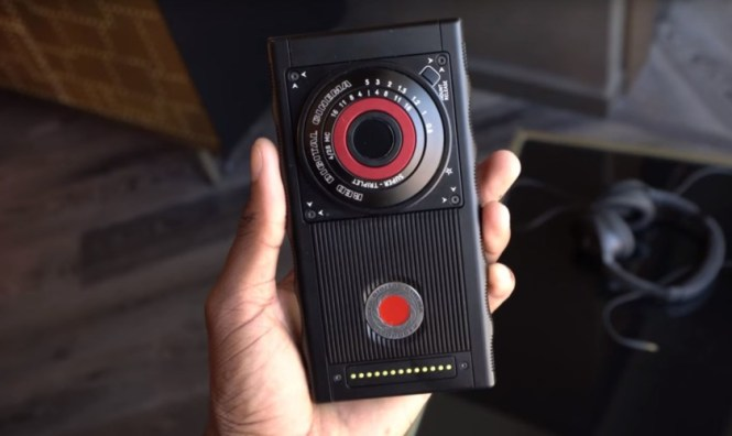 red hydrogen one held in hand back side camera red button