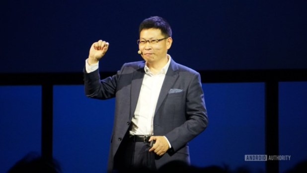 Huawei's Richard Yu holding the Kirin 970 chipset.