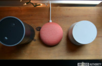 Amazon Echo, Google Home Mini, and Google Home top-down image on wood table.