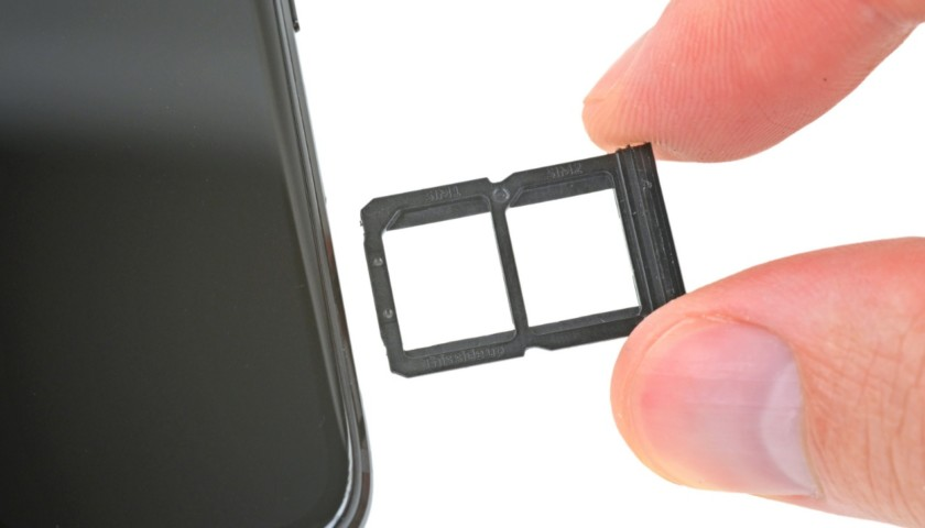 A closeup of the SIM card tray seen during a OnePlus 6 teardown.