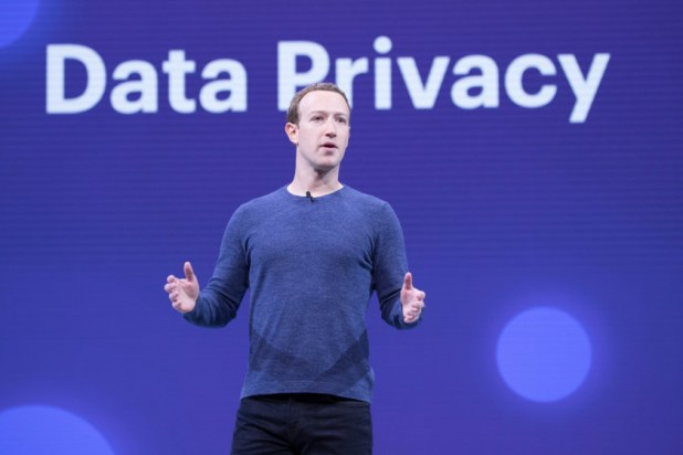 "An image of Mark Zuckerberg standing in front of a backdrop that says ""Data Privacy"" in large letters."