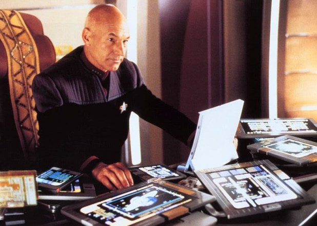 Captain Picard with PADD in Star Trek