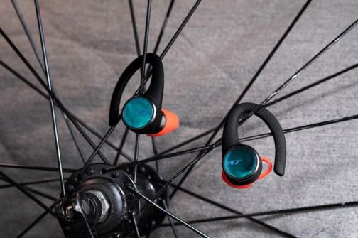 Plantronics BackBeat Fit 3100 true wireless earbuds on bike spokes.