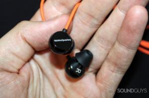 Beyerdynamic headphones in a person's hand.