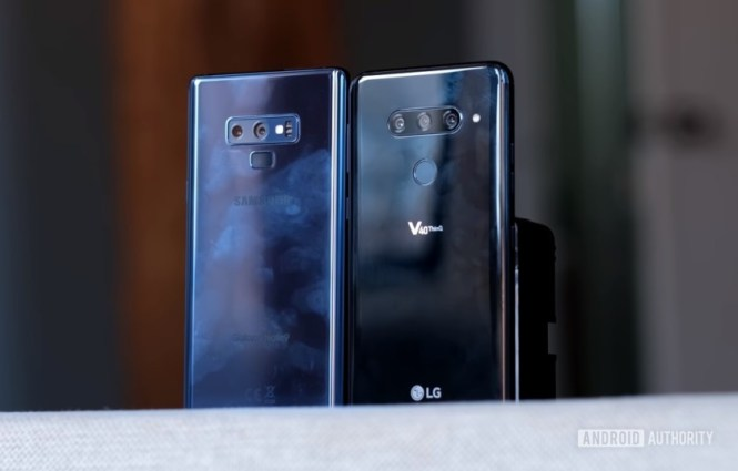 The LG V40 ThinQ and the Samsung Galaxy Note 9 standing next to each other on a shelf.