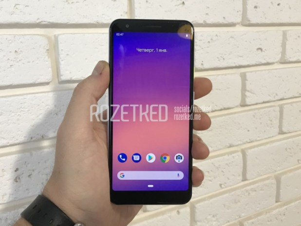 Photo of the speculated Google Pixel 3 Lite/Pixel 3 XL Lite held in a hand with the screen turned on.
