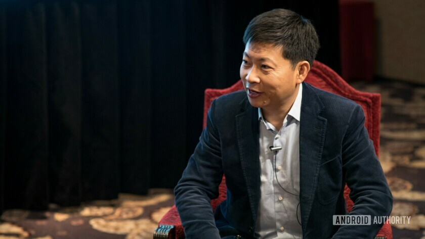 Huawei consumer business group CEO Richard Yu on a red chair.