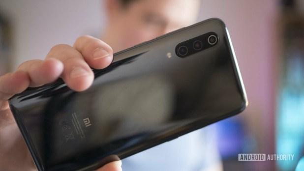The Xiaomi Mi 9 held in the hand