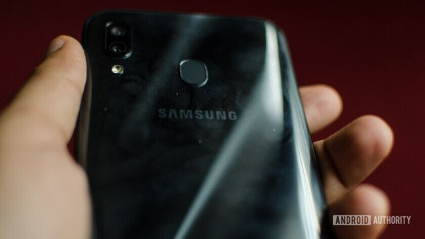 Samsung Galaxy A30 back showing scuffs and fingerprints