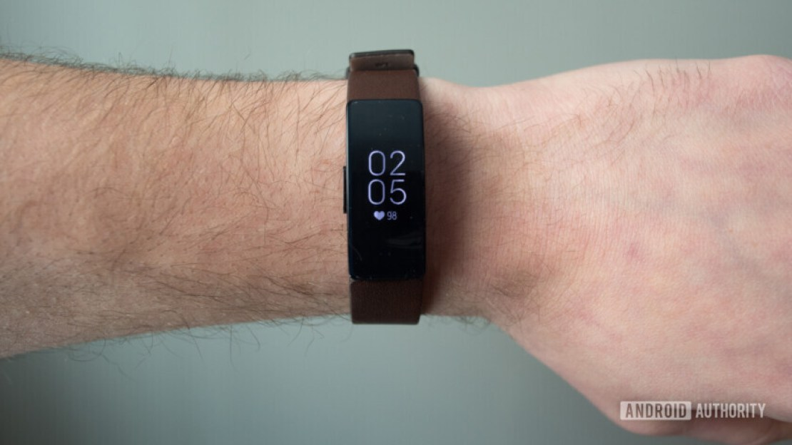 fitbit inspire hr display brown leather strap on wrist