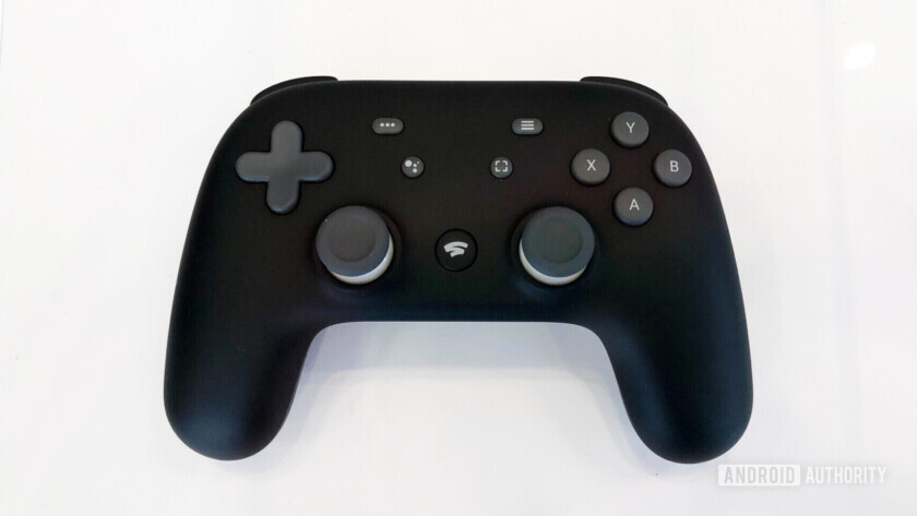 Top view of the google stadia controller in black color against a white background.