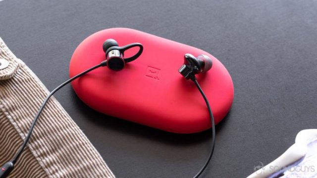 OnePlus Bullets Wireless 2: The old Bullets Wireless on the left and new on the right. They're sitting on the red carrying pouch.