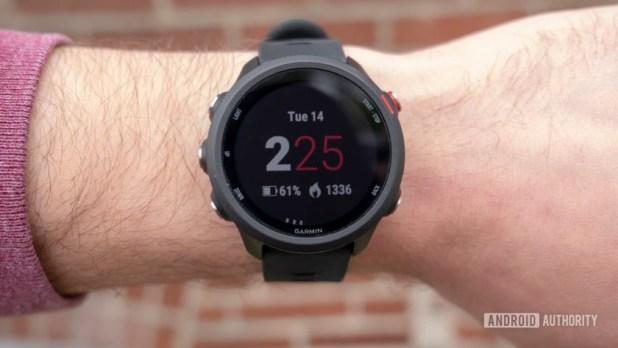 garmin forerunner 245 music running watch on wrist watch face display