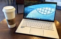 Asus Chromebook Flip C434 on table with coffee