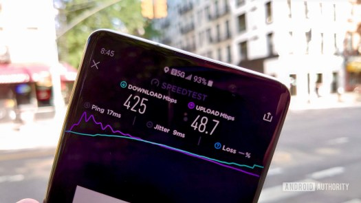 Phone in hand showing T-Mobile 5G Speed Test