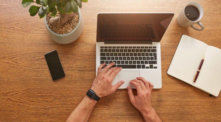 Man typing or coding on laptop