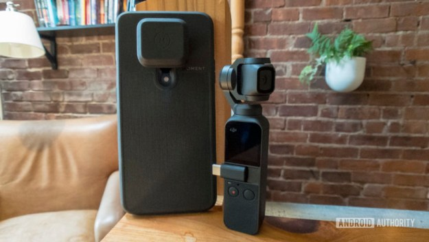 A OnePlus 7 Pro with a Moment case and a Moment lens attached, next to a DJI Osmo Pocket camera.