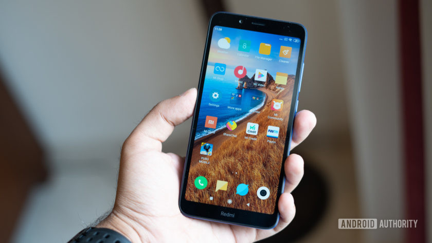 Xiaomi Redmi 7A in hand showing display
