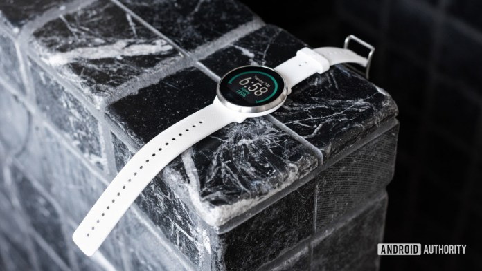 The best Polar watch: Polar Ignite smart fitness watch lying flat on tiled surface.