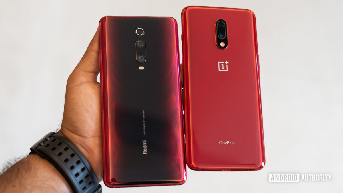 Redmi K20 Pro versus OnePlus 7 with the back of the phones in hand