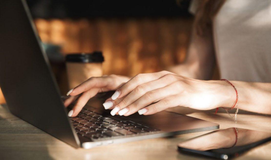 Woman Typing Coding Laptop Outside