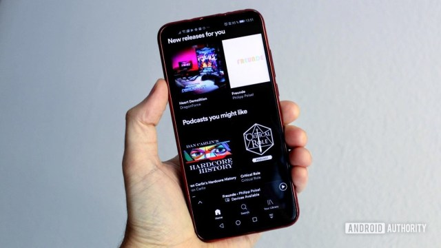 Spotify menu on a smartphone in a person's hand