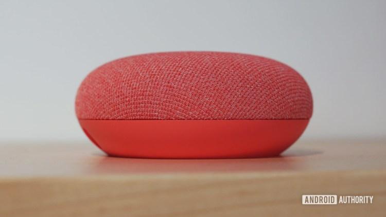 Google Nest Mini closeup in Coral color