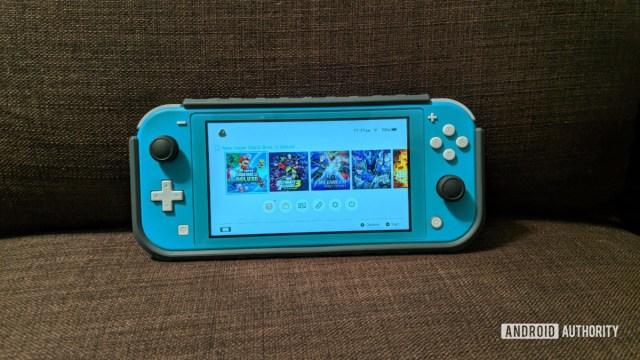 Nintendo Switch Lite on a sofa