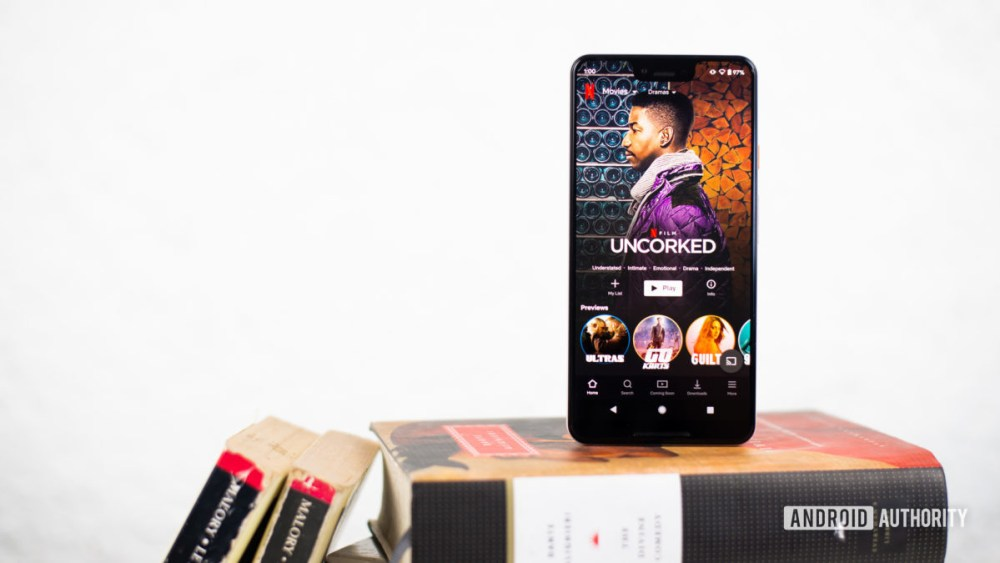 Netflix play on smartphone stock photo4