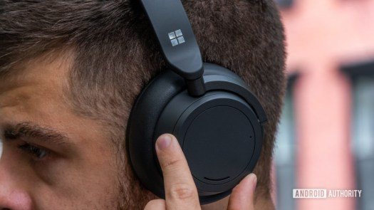 A picture of a man wearing the Microsoft Surface Headphones 2