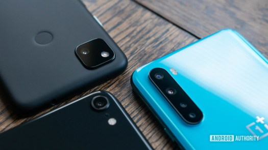 Pixel 4a vs iPhone SE vs OnePlus Nord cameras together angled