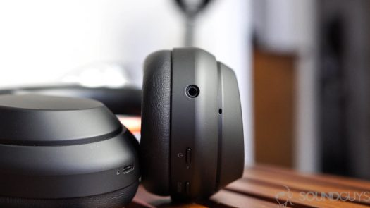 A photo of the Sony WH 1000XM4 noise cancelling headphones inputs and buttons on the ear cups.