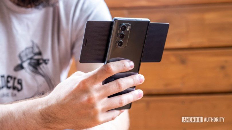 LG Wing back of device open in hand 4