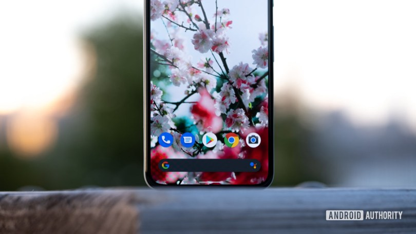 Google Pixel 5 standing up on table assistant bar macro 1