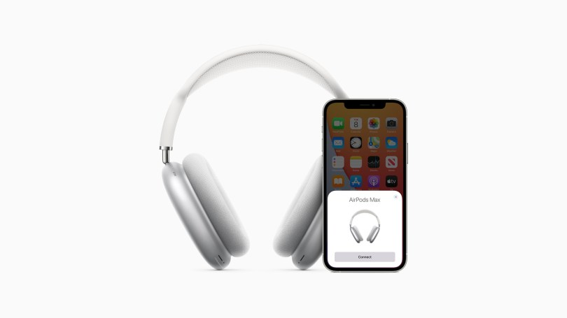 AirPods Max pairing to iOS phone on a white background.