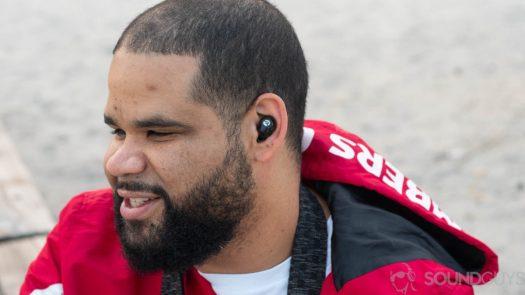 A man wears the Raycon E25 earbuds.