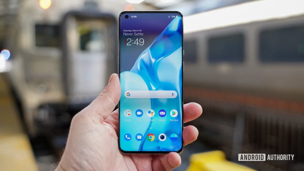 OnePlus 9 Pro in hand display