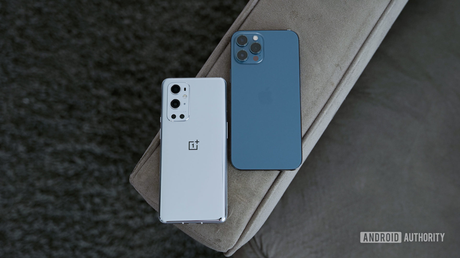 OnePlus 9 Pro vs iPhone 12 Pro Max on the arm of the sofa