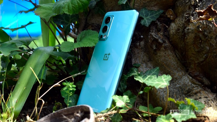 OnePlus Nord 2 5G side on lying against a tree