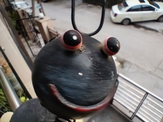 The OnePlus Nord Macro camera show of a metal ornament with a smiley face.