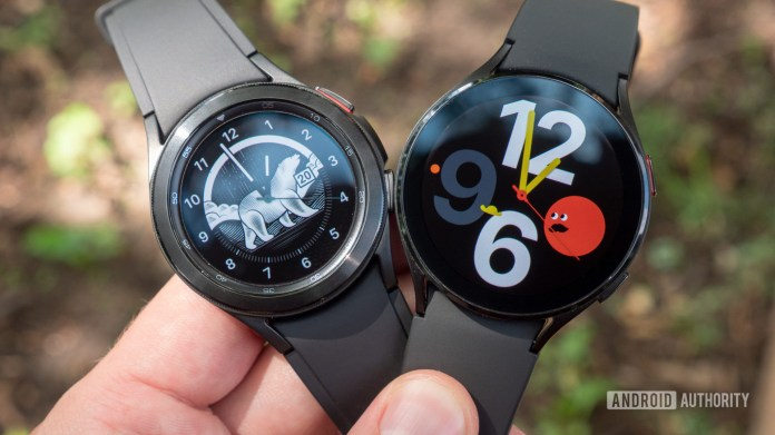 The Samsung Galaxy Watch 4 and Samsung Galaxy Watch 4 Classic being held in someone's hand.